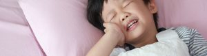 Kid in pain from a common dental issue and tips from Harrisburg Pediatric Dentistry.